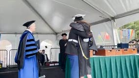 Video shows US Marine surprising sister at college graduation ceremony