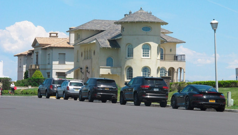 Cars are parked on an oceanfront street in Deal, N.J., on May 15, 2021s