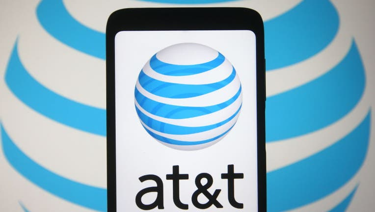 In this photo illustration the AT&T logo is seen on a smartphone and a background screen. (Photo Illustration by Pavlo Gonchar/SOPA Images/LightRocket via Getty Images)
