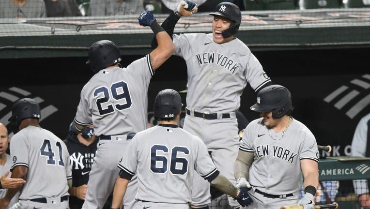 Gio Urshela #29 of the New York Yankees celebrates a pinch hit three run home run