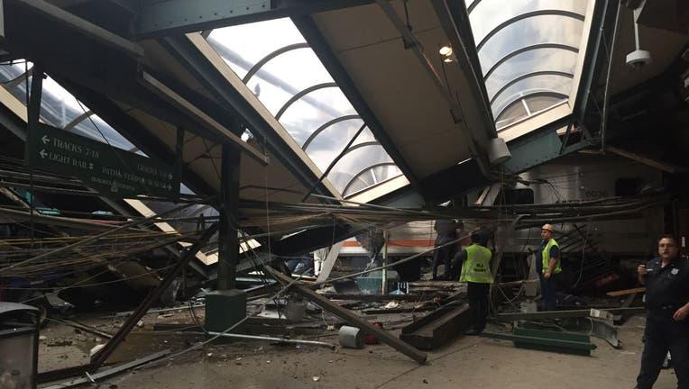 A NJ Transit train seen through the wreckage.