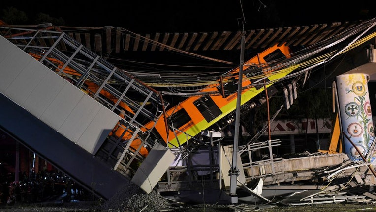 A general view shows the site of a train accident after an elevated metro line collapsed in Mexico City on May 4, 2021.