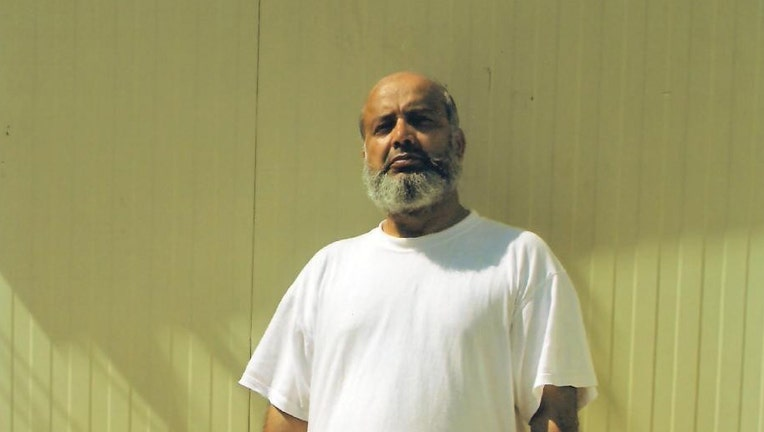 Saifullah Paracha, shown posing for an International Committee of the Red Cross delegate at Guantanamo, has balked at having a medical procedure done on his heart at the U.S. Navy base in Guantanamo.