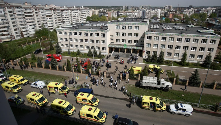 KAZAN, RUSSIA MAY 11, 2021: Ambulances and police cars at school No 175 where two attackers opened fire; at least one teacher and eight students are reported dead.