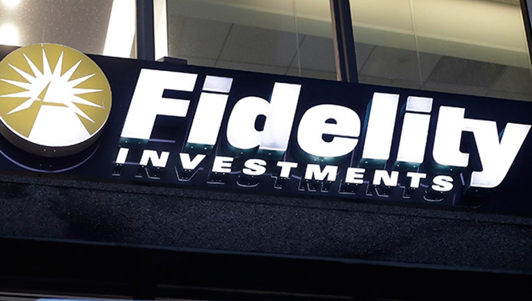 In this Oct. 14, 2019 file photo a Fidelity Investments logo is attached to a building, in Boston. Fidelity is launching a new type of account for teenagers to save, spend and invest their money. The account is for 13- to 17-year-olds, and it will allow them to deposit cash, have a debit card and trade stocks and funds. (AP Photo/Steven Senne, File)