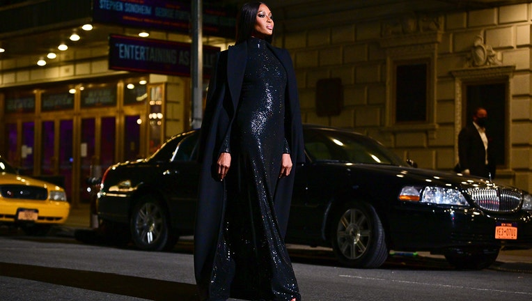 Naomi Campbell walks along 46th Street during the Michael Kors Fashion Show in Times Square on April 08, 2021 in New York City. (Photo by James Devaney/GC Images)