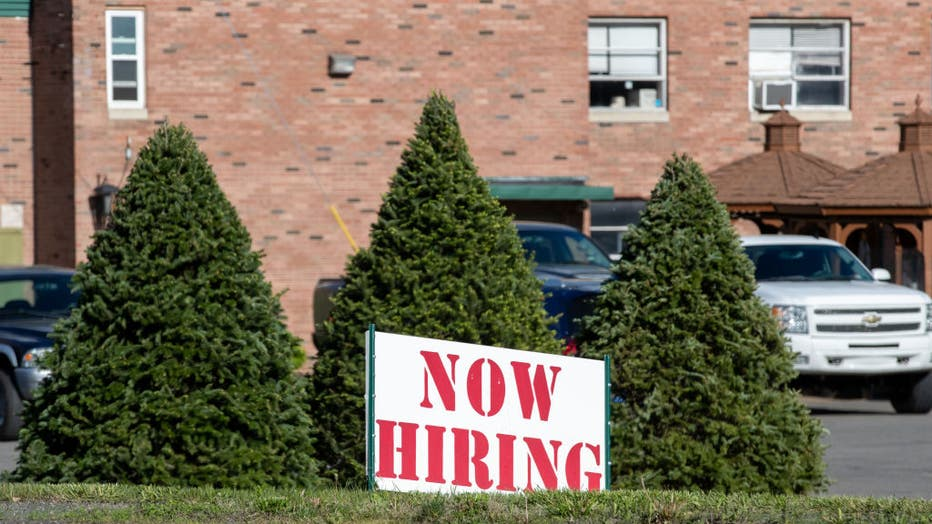A now hiring sign is seen outside the International Paper's