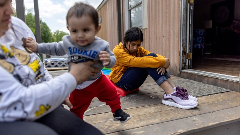 Honduran immigrant Nani, 10, pauses after moving in with her extended family