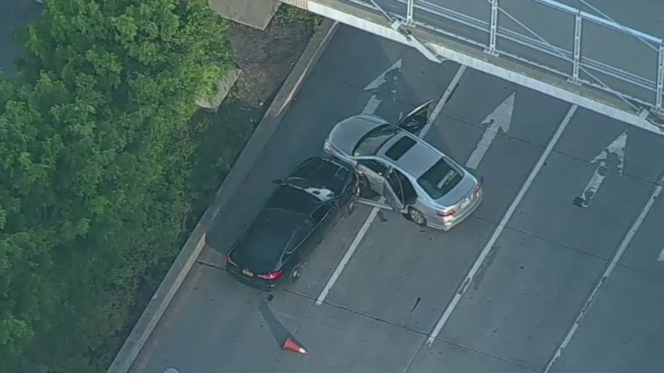 The driver of a grey Toyota Camry rammed the vehicle on the West Side Highway into a police cruiser. Photo shows stolen vehicle. Unclear if dark-colored vehicle belongs to NYPD.