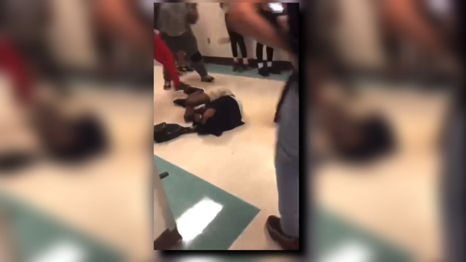Teen covers head during attack (1)