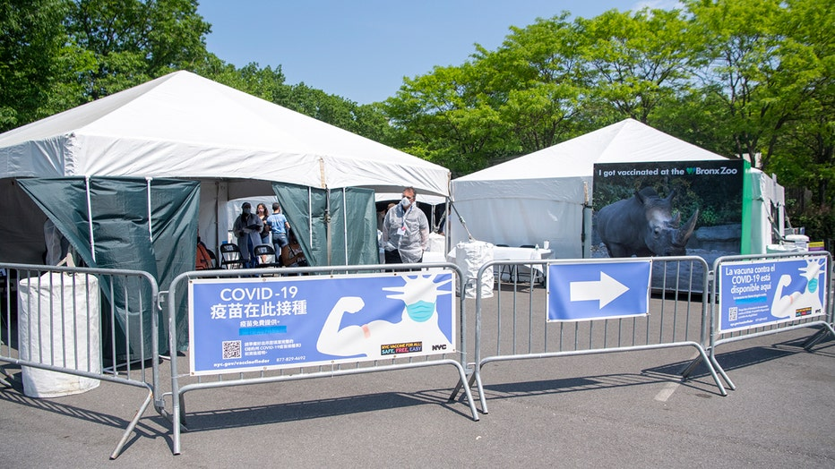 Temporary medical tents and metal barricades in a parking lot at the Bronx Zoo