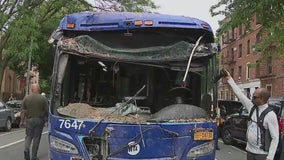 Bus removed from Brooklyn brownstone after crash