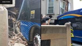 Bus slams into Brooklyn townhouse