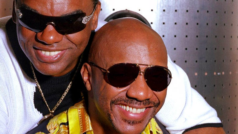 FILE - In this Aug. 1, 2001, file photo, the Rock and Roll Hall of Fame-inducted group, The Isley Brothers Ronald, left, and Ernie pose in New York.