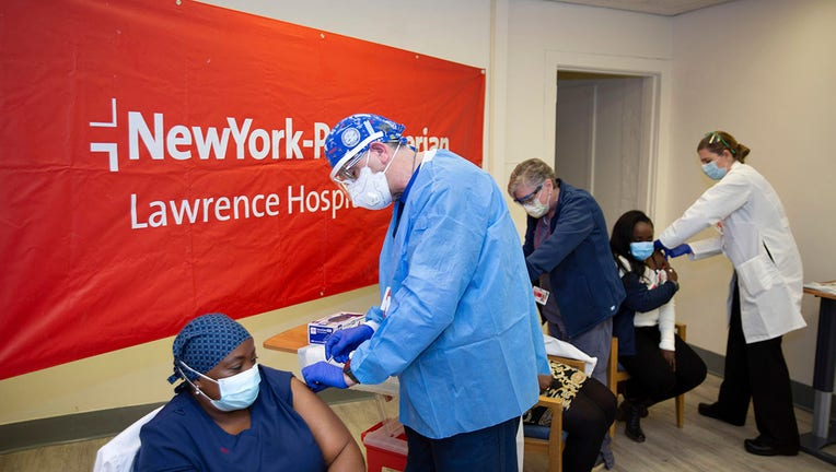 Doctors inject sisters Claudia Scott-Mighty, left, Althea Scott-Bonaparte, who are patient care directors, and Christine Scott, an ICU nurse, with their second shot of the Pfizer vaccine at NewYork-Presbyterian Lawrence Hospital on Friday, Jan. 8, 2021, in Bronxville, N.Y.