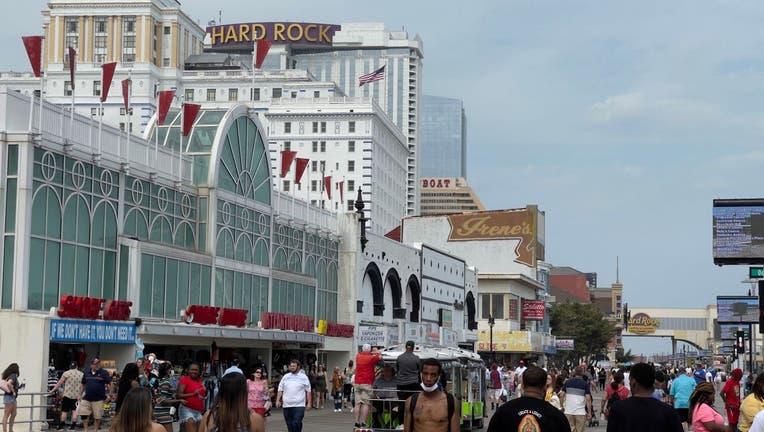 People walk on the boardwalk in Atlantic City, New Jersey