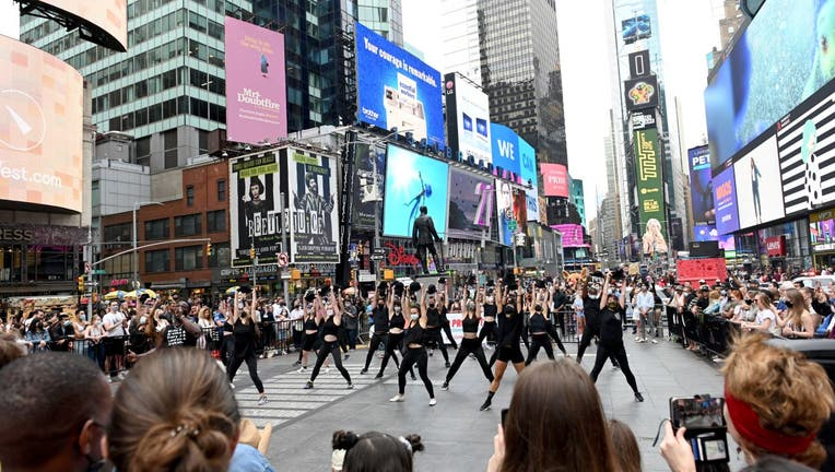 People gather around to watch dancers during the