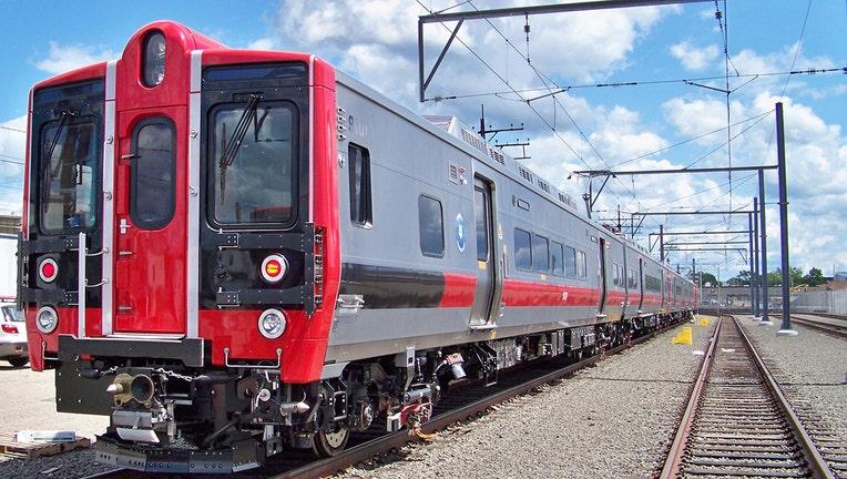 A commuter train in a rail yard