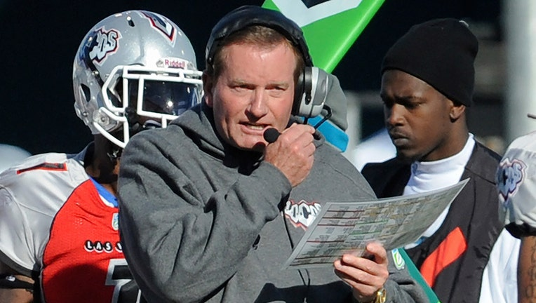 FILE - In this Nov. 27, 2010, file photo, then Las Vegas head coach Jim Fassel, center, looks on from the sideline during their United Football League title game against Florida in Omaha, Neb.