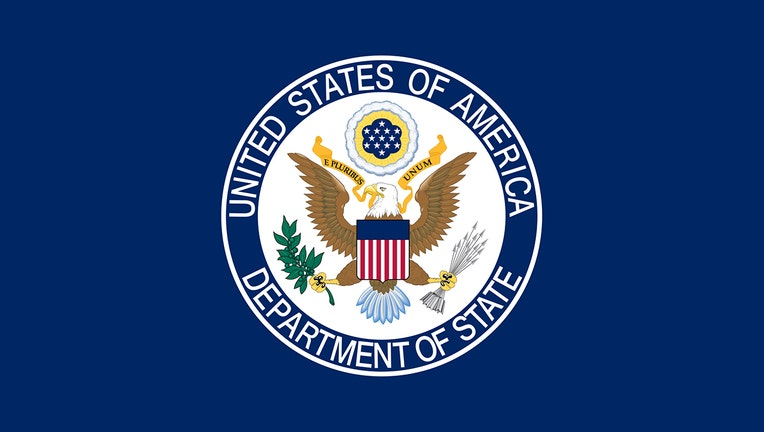 The flag of the U.S. State Department features a US eagle seal against a blue backdrop