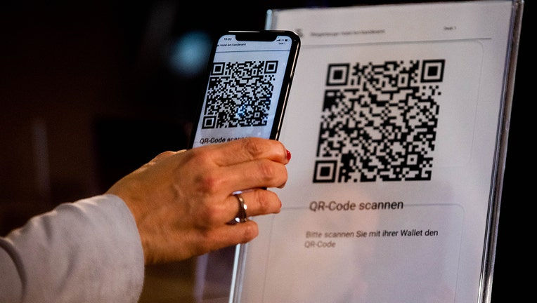 A ID wallet is on display on the screen of a mobile phone at a hotel in Berlin, Germany.(Photo by Filip Singer-Pool/Getty Images)
