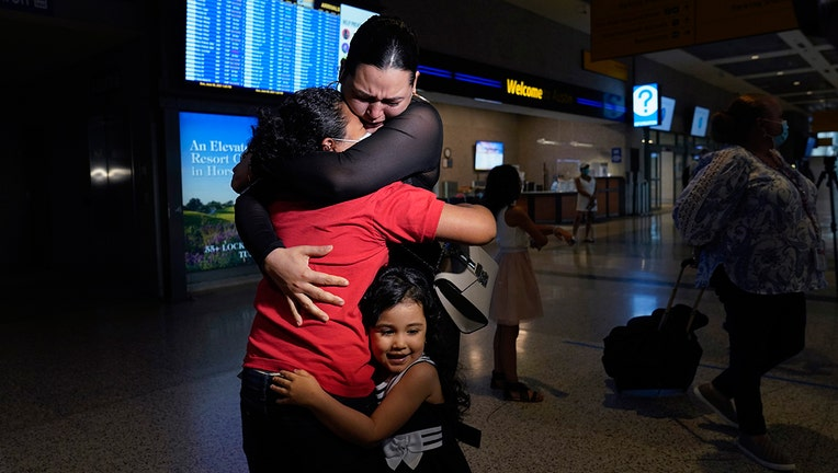 Emely, left, is reunited with her mother, Glenda Valdez and sister, Zuri, at Austin-Bergstrom International Airport, Sunday, June 6, 2021, in Austin, Texas.(AP Photo/Eric Gay)