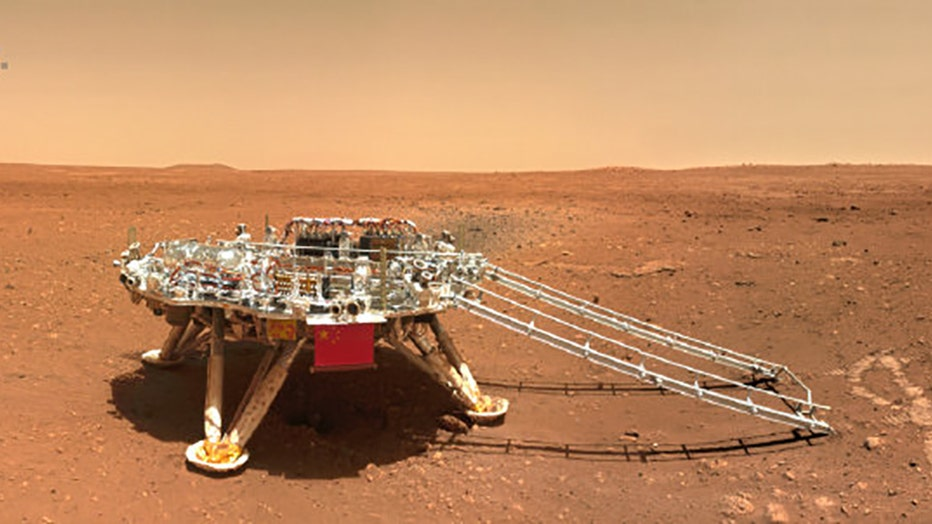 A space landing platform on the surface of Mars; the platform Chinese national flag and outlines of the mascots for the 2022 Beijing Winter Olympics and Paralympics