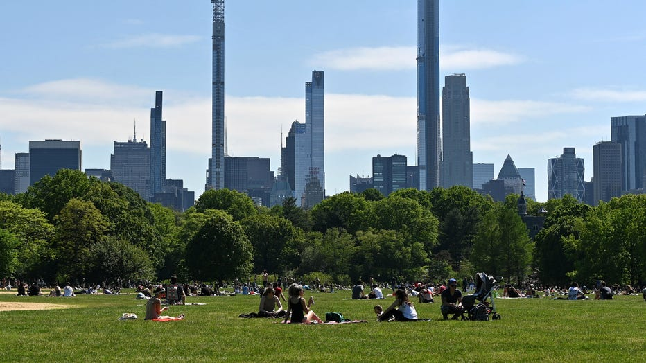 NEW YORK, NEW YORK - MAY 25: People sit on The Great Lawn in Central Park on Memorial Day during the coronavirus pandemic on May 25, 2020 in New York City.