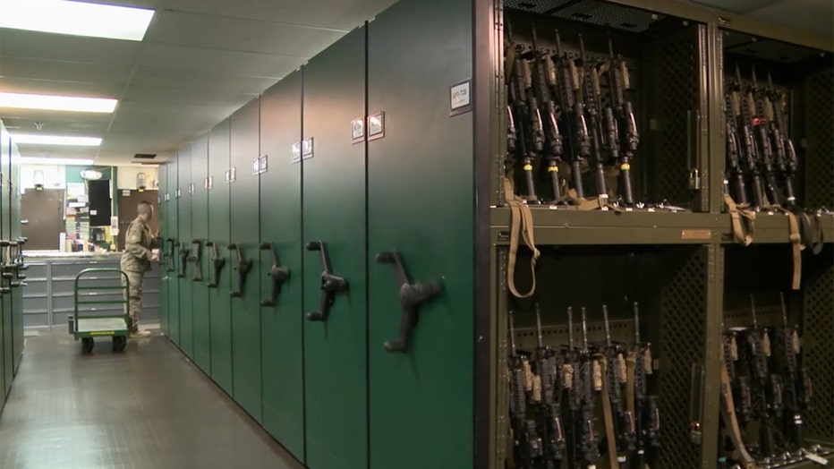 A large vault containing military rifles