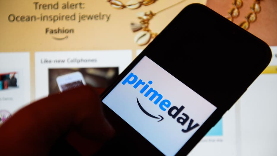 9e39a78f-In this photo illustration an Amazon Prime day logo seen