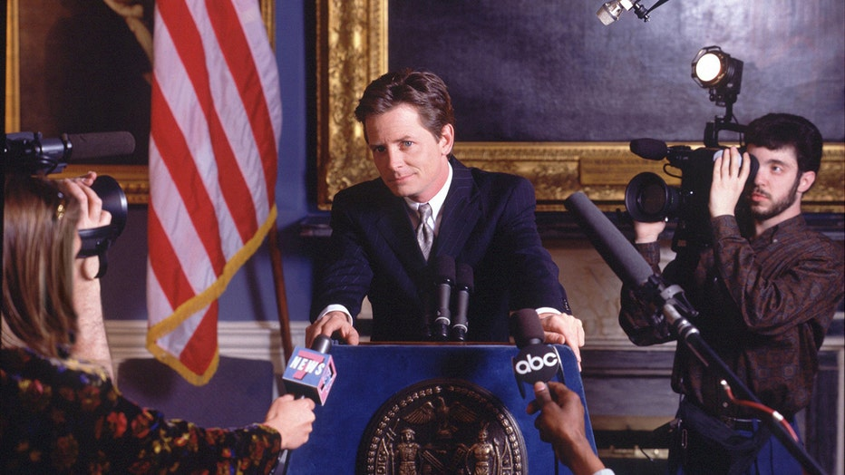 This 1996 photo shows Michael J. Fox on the situation Spin City. The comedy takes place in New York's City Hall. It centers on Fox (as Mike Flaherty, the deputy mayor), who has to protect the slightly moronic mayor, Randall Winston from those who want to ruin his political career, and from himself. (Photo by Timothy White/Walt Disney Television via Getty Images) MICHAEL J. FOX