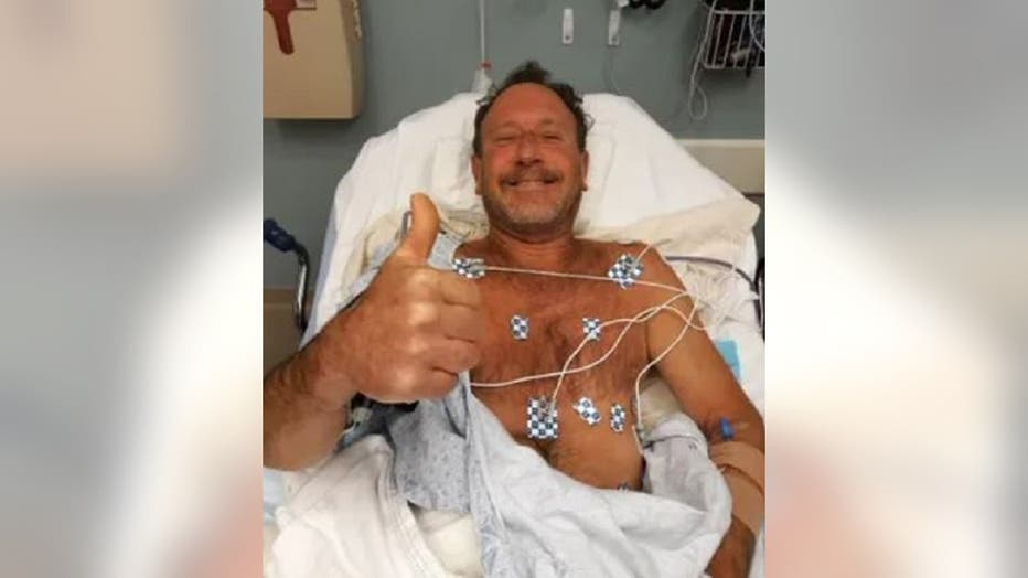 Michael Packard, 56, recovers in a Cape Cod hospital after being swallowed by a humpback whale Friday off the coast of Massachusetts. (Packard family)