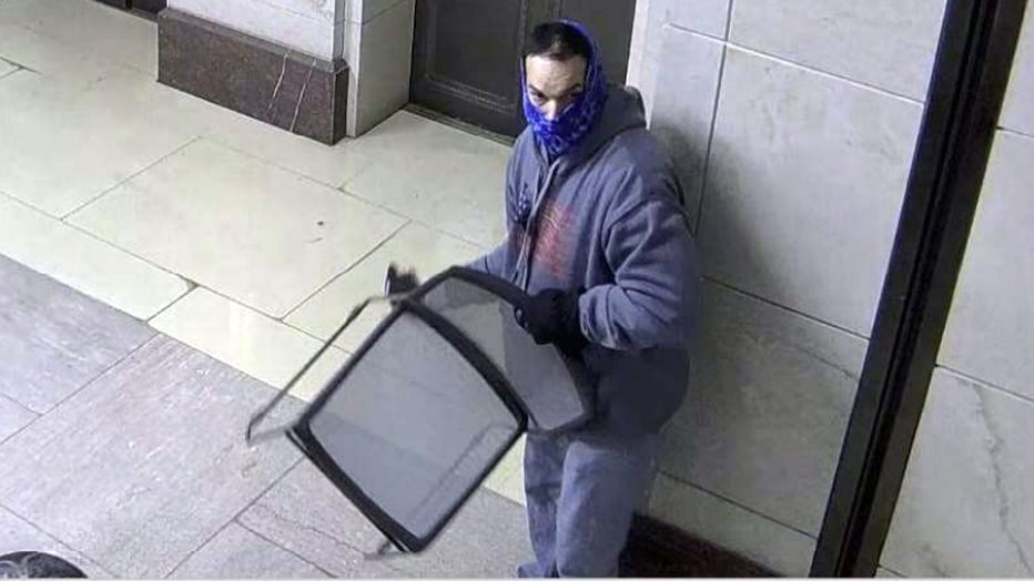 suspect-with-chair.jpg