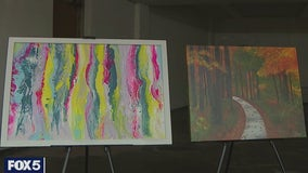 An exhibit of artwork brightens otherwise empty storefronts
