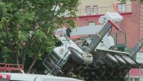 Construction crane collapses onto Queens building, store
