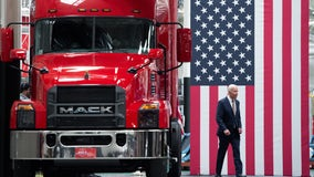 Biden pushes 'buy American' efforts, energy investments at truck plant