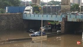 Heavy rain triggers flash floods in subways, on highways
