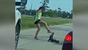 Woman tries to remove alligator from Louisiana highway