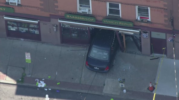 Car runs over mom and baby, crashes into barbershop