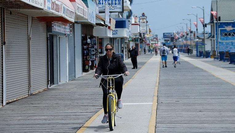 A woman biking along a boardwalk
