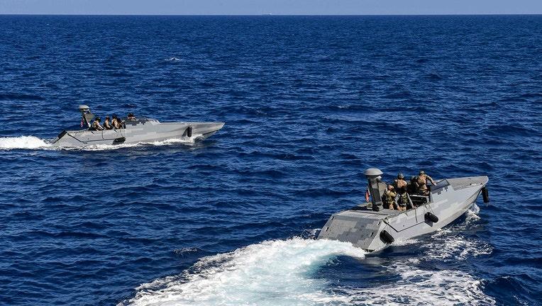 Two slate gray vessels in the Mediterranean Sea