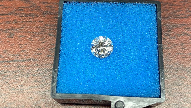 A TSA agent at JFK Airport found a missing diamond from the engagement ring of a newlywed couple traveling to Guam.
