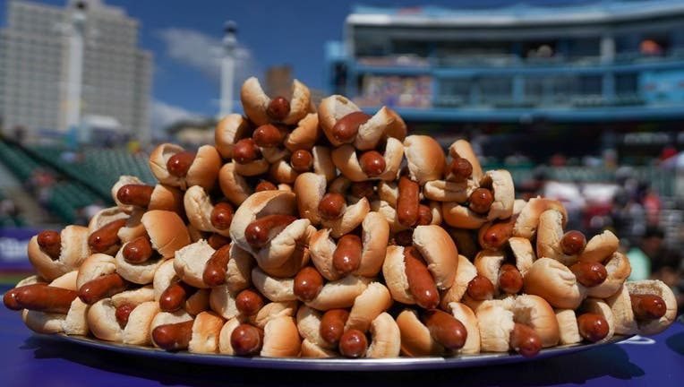 Hot dogs are prepared for the 2021 Nathan's Famous 4th Of July International Hot Dog Eating Contest on July 4, 2021 in New York City.