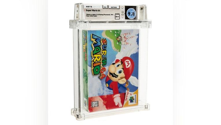 A Super Mario 64 game cartridge inside a plastic case