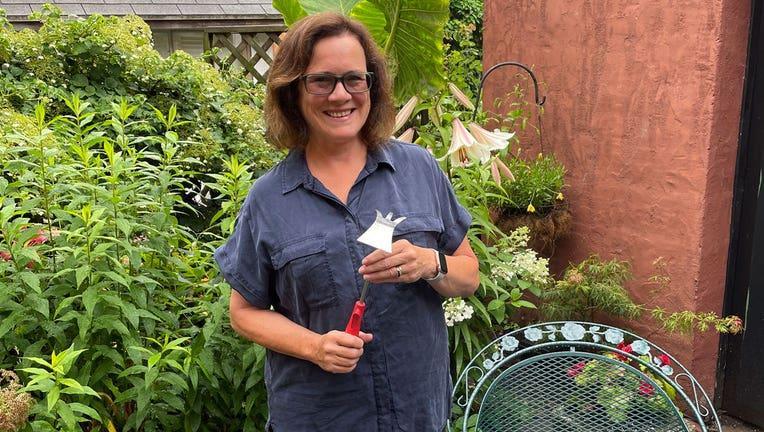 Elizabeth Licata, moderator of the Facebook group, WNY Gardeners, poses for a photograph on July 8, 2021 in Buffalo, N.Y. (Elizabeth Licata via AP)