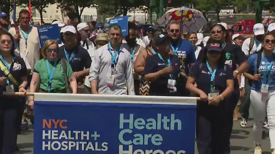 Health care workers from NYC Health + Hospitals march in the Hometown Heroes Parade.