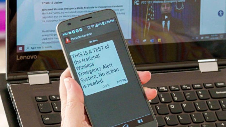 Florida, Miami Beach, National Wireless Emergency Alert System, smartphone and laptop
