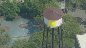 NYPD, graffiti artist in 12-hour-long standoff at Brooklyn water tower