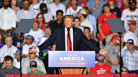 Trump targets Biden over Afghanistan but gets booed briefly on vaccines at Alabama rally
