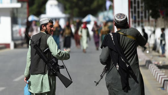 Taliban hang dead body in Afghan city's main square